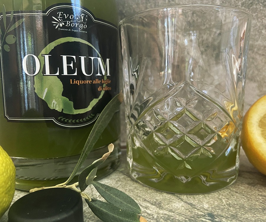 Liquor with olive leaves